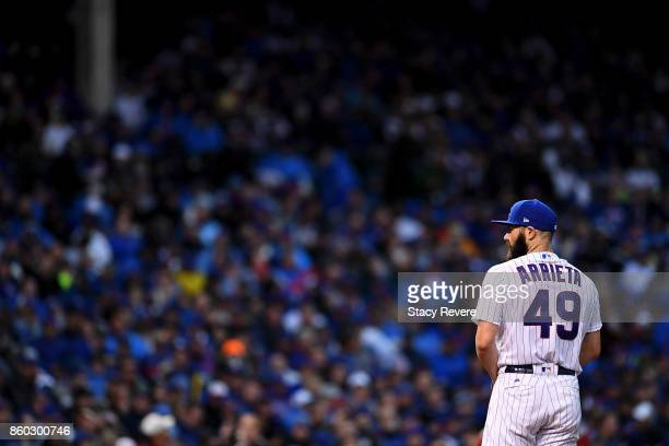 Jake Arrieta of the Chicago Cubs pitches in the fourth inning during game four of the National League Division Series against the Washington...