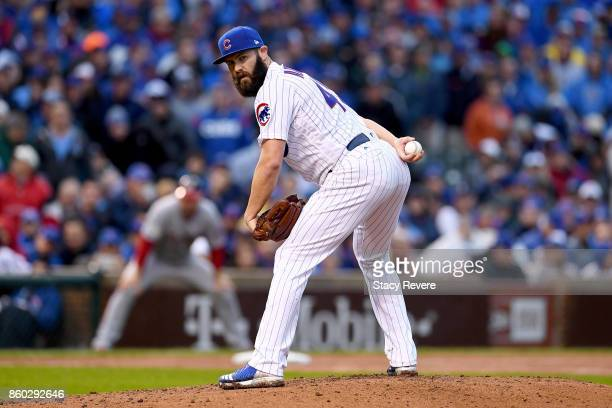 Jake Arrieta of the Chicago Cubs pitches in the third inning during game four of the National League Division Series against the Washington Nationals...