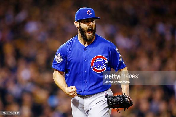 Jake Arrieta of the Chicago Cubs reacts after a double play to end the sixth inning with the bases loaded during the National League Wild Card game...