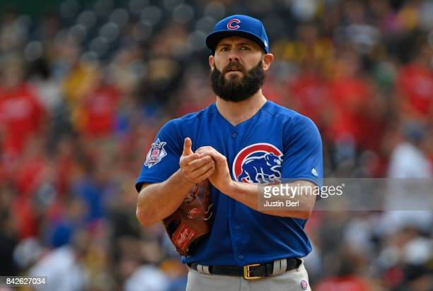 Jake Arrieta of the Chicago Cubs reacts after giving up a single to David Freese of the Pittsburgh Pirates in the first inning during the game at PNC...