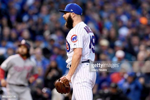 Jake Arrieta of the Chicago Cubs reacts after the end of the top of the fourth inning during game four of the National League Division Series against...