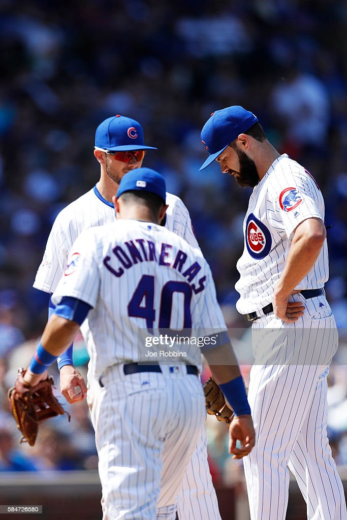 Jake Arrieta #49 of the Chicago Cubs reacts before being taken out of the game in the eighth inning against the Seattle Mariners at Wrigley Field on July 30, 2016 in Chicago, Illinois. The Mariners defeated the Cubs 4-1.
