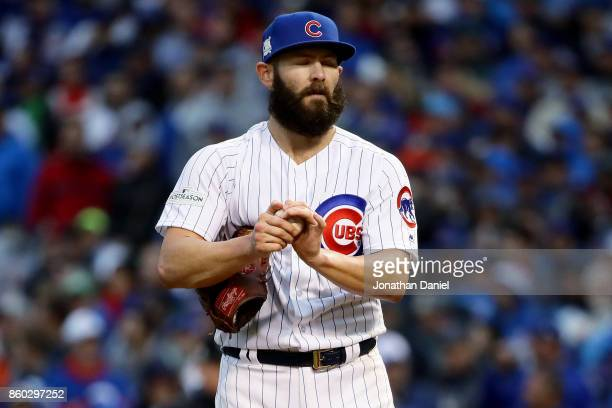 Jake Arrieta of the Chicago Cubs reacts in the third inning during game four of the National League Division Series against the Washington Nationals...