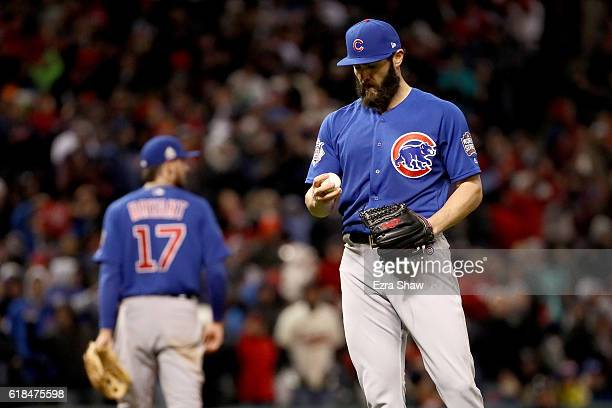 Jake Arrieta of the Chicago Cubs reacts on the pitcher's mound after a double by Jason Kipnis of the Cleveland Indians during the sixth inning in...