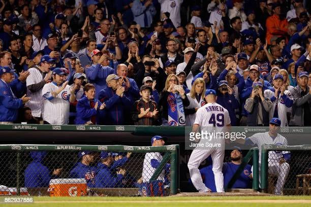 Jake Arrieta of the Chicago Cubs receives a standing ovation after being relieved in the seventh inning against the Los Angeles Dodgers during game...