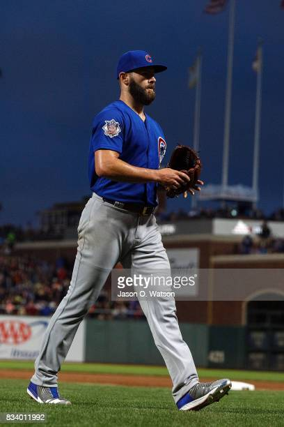 Jake Arrieta of the Chicago Cubs returns to the dugout during the fourth inning against the San Francisco Giants at ATT Park on August 7 2017 in San...