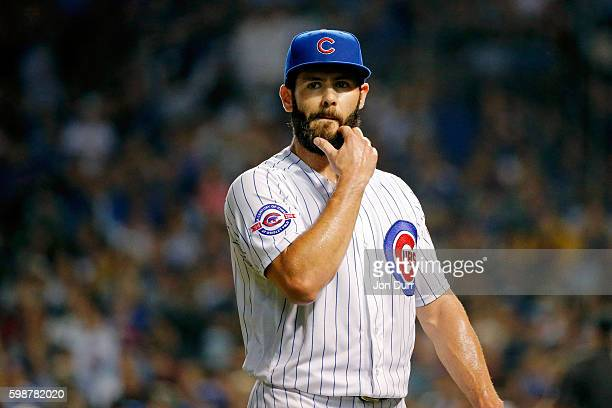 Jake Arrieta of the Chicago Cubs scratches his beard as he walks back to the dugout at the end of sixth inning after giving up a three run home run...