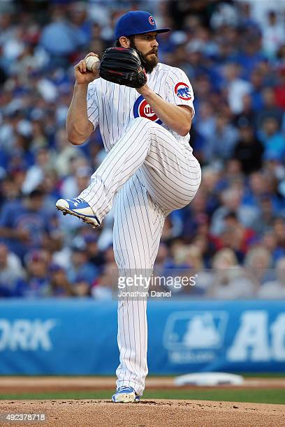Jake Arrieta of the Chicago Cubs throws a pitch in the first inning against the St Louis Cardinals during game three of the National League Division...