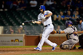 Jake Arrieta of the Chicago Cubs tries to bunt during the thirteenth inning aColorado Rockies on July 30 2014 at Wrigley Field in Chicago Illinois...