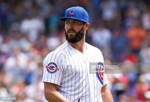 Jake Arrieta of the Chicago Cubs walks back to the dugout between innings against the St Louis Cardinals at Wrigley Field on June 22 2016 in Chicago...