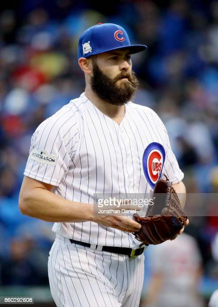 Jake Arrieta of the Chicago Cubs walks off the field in the second inning during game four of the National League Division Series against the...