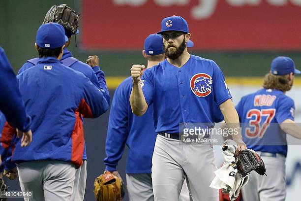 Jake Arrieta of the Chicago Cubs walks to the dugout before the start of the game against the Milwaukee Brewers at Miller Park on October 02 2015 in...