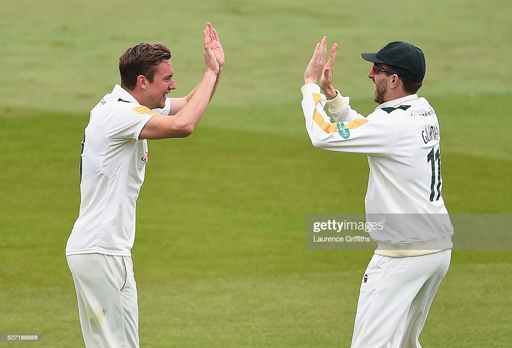 Jake Ball and Harry Gurney of Nottinghamshire celebrate the wicket of Joe Root of Yorkshire during the Specsavers County Championship Division One match between Nottinghamshire and Yorkshire at Trent Bridge on May 2, 2016 in Nottingham, England.