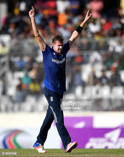 Jake Ball of England celebrates dismissing Mushfiqur Rahim of Bangladesh during the 2nd One Day International match between Bangladesh and England at...