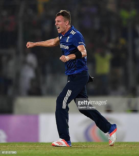 Jake Ball of England celebrates dismissing Sabbir Rahman of Bangladesh during the 1st One Day International match between Bangladesh and England at...