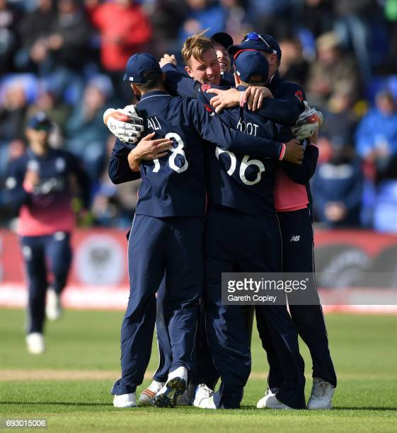 Jake Ball of England celebrates with teammates after dismissing Ross Taylor of New Zealand during the ICC Champions Trophy match between England v...