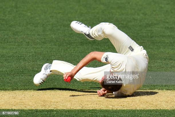 Jake Ball of England falls and injuries himself while bowling during day two of the Four Day Tour match between the Cricket Australia XI and England...