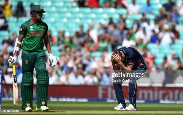 Jake Ball of England reacts after Moeen Ali drops Soumya Sarkar of Bangladesh during the ICC Champions Trophy group match between England and...