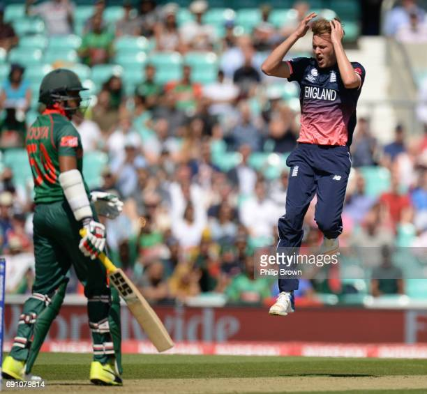 Jake Ball of England reacts after Soumya Sarkar of Bangladesh was dropped by Moeen Ali during the ICC Champions Trophy match between England and...