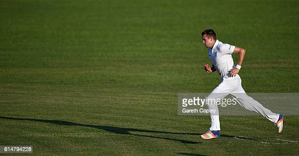 Jake Ball of England runs into bowl during a tour match between a Bangladesh Cricket Board XI and England at MA Aziz stadium on October 15 2016 in...