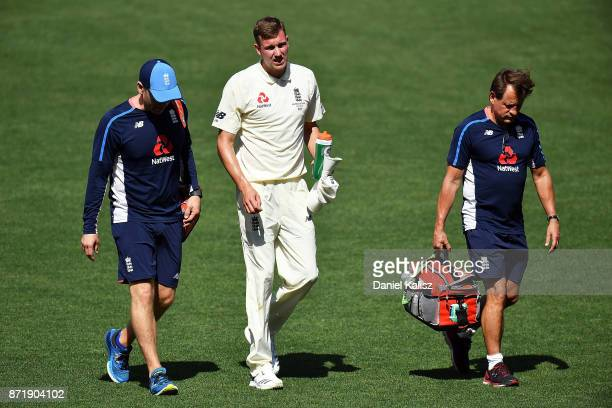 Jake Ball of England walks from the field after falling and injuring himself whilst bowling during day two of the Four Day Tour match between the...