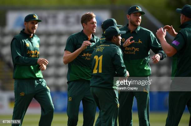 Jake Ball of Nottinghamshire celebrates with teammates after dismissing Tom KohlerCadmore of Worcestershire during the Royal London OneDay Cup match...