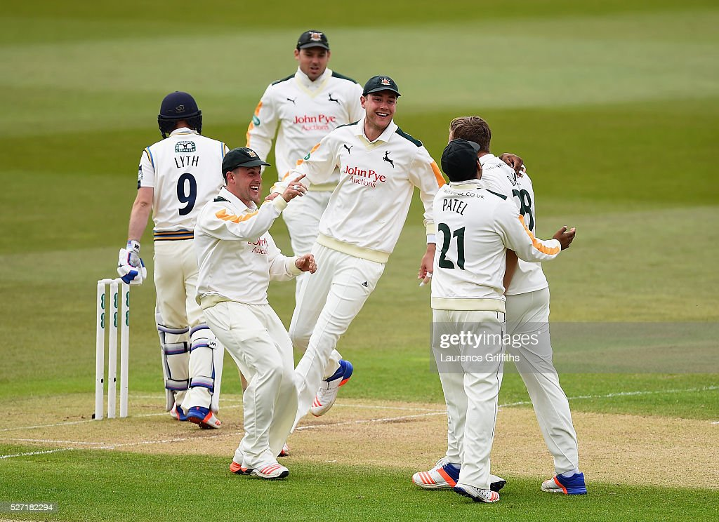 Jake Ball of Nottinghamshire is congratulated by Steven Mullaney and <a gi-track='captionPersonalityLinkClicked' href=/galleries/search?phrase=Stuart+Broad&family=editorial&specificpeople=574360 ng-click='$event.stopPropagation()'>Stuart Broad</a> on the wicket of Adam Lyth of Yorkshire during the Specsavers County Championship Division One match between Nottinghamshire and Yorkshire at Trent Bridge on May 2, 2016 in Nottingham, England.