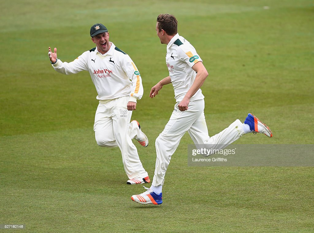 Jake Ball of Nottinghamshire is congratulated by Steven Mullaney on the wicket of Joe Root of Yorkshire during the Specsavers County Championship Division One match between Nottinghamshire and Yorkshire at Trent Bridge on May 2, 2016 in Nottingham, England.