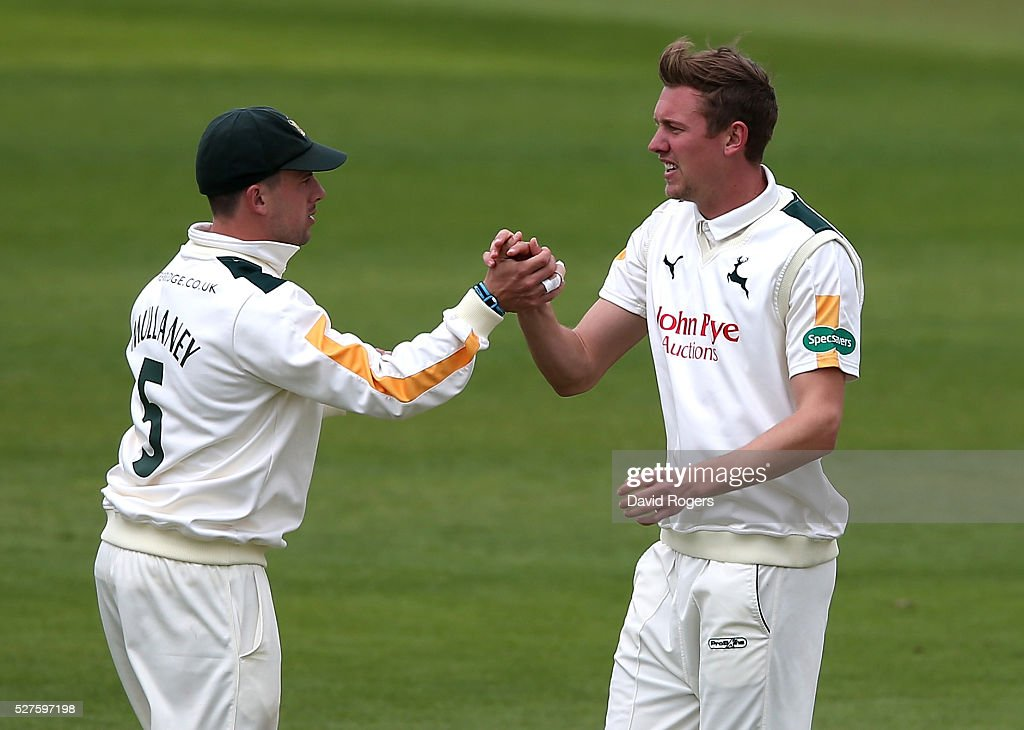 Jake Ball (R) of Nottinghamshire is congratulated by team mate Steven Mullaney after taking the wicket of Andrew Gale during the Specsavers County Championship division one match between Nottinghamshire and Yorkshire at the Trent Bridge on May 3, 2016 in Nottingham, England.