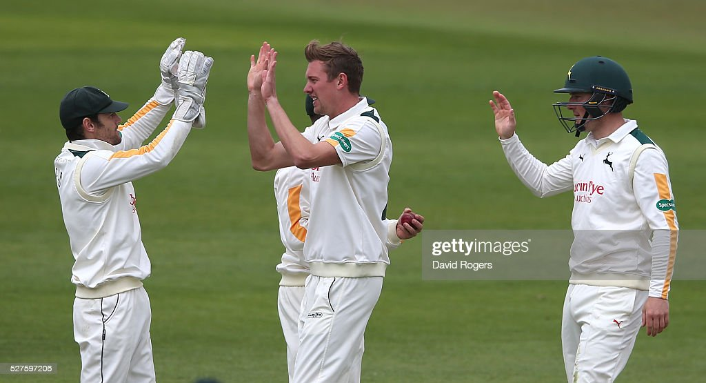 Jake Ball (C) of Nottinghamshire is congratulated by team mate Steven Mullaney (L) after taking the wicket of Andrew Gale during the Specsavers County Championship division one match between Nottinghamshire and Yorkshire at the Trent Bridge on May 3, 2016 in Nottingham, England.