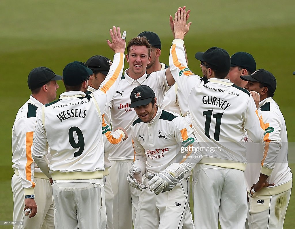 Jake Ball of Nottinghamshire is congratulated on the wicket of Gary Ballance of Yorkshire during the Specsavers County Championship Division One match between Nottinghamshire and Yorkshire at Trent Bridge on May 2, 2016 in Nottingham, England.
