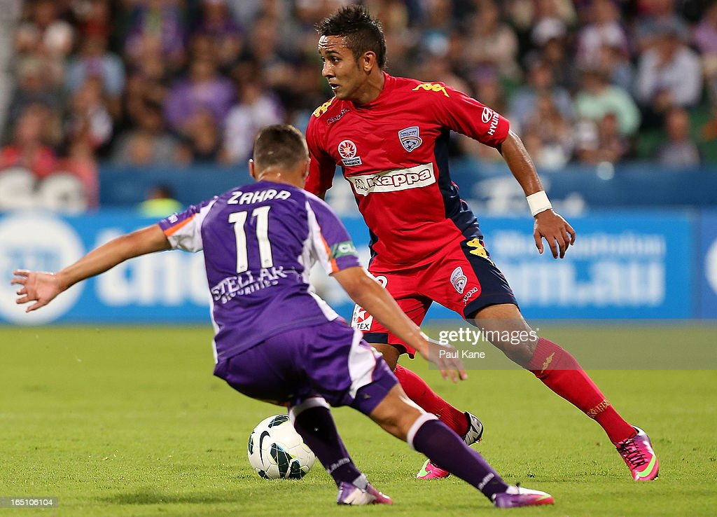 Jake Barker-Daish of Adelaide is challenged for the ball by Adrian Zahra of the Glory during the round twenty seven A-League match between Perth Glory and Adelaide United at nib Stadium on March 30, 2013 in Perth, Australia.