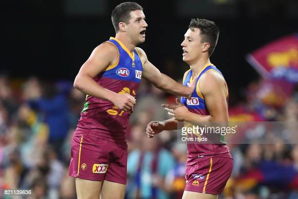 Jake Barrett of the Lions celebrates a goal during the round 18 AFL match between the Brisbane Lions and the Carlton Blues at The Gabba on July 23...