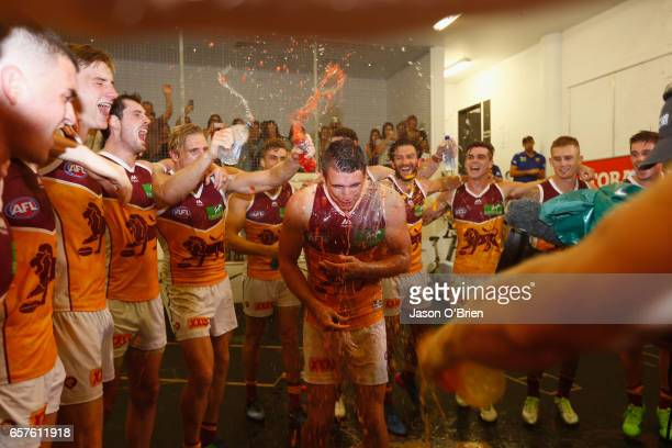 Jake Barrett of the Lions sings the team song during the round one AFL match between the Gold Coast Suns and the Brisbane Lions at Metricon Stadium...