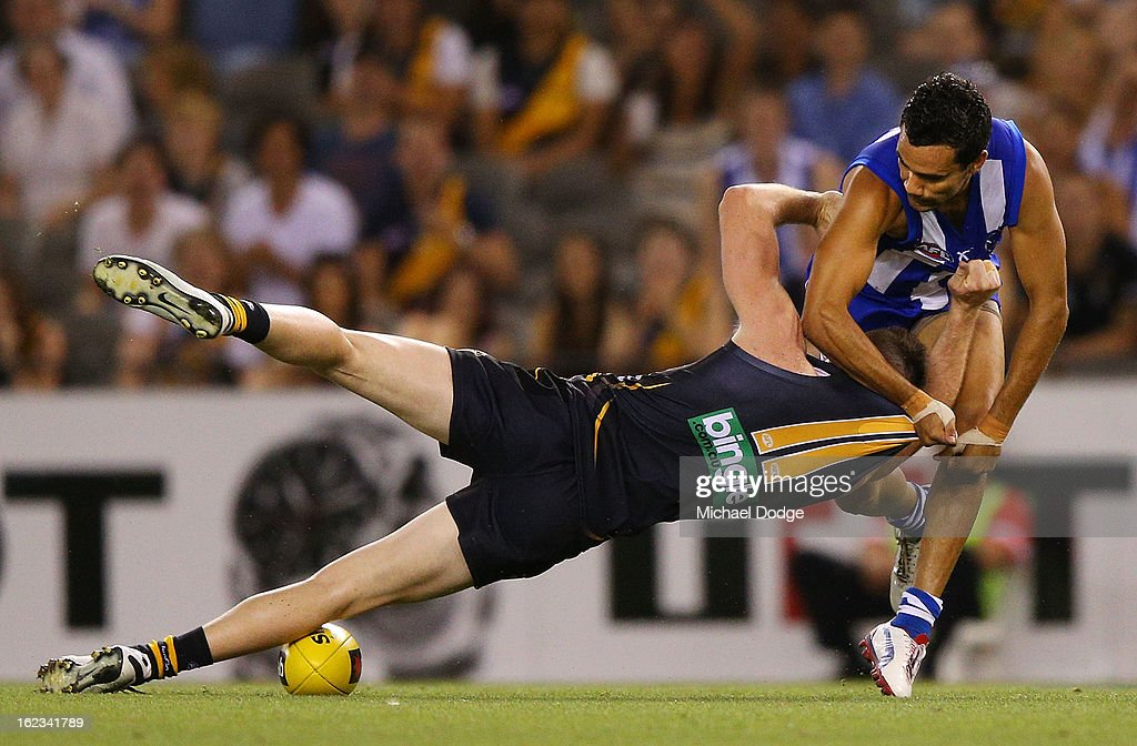 Jake Batchelor of the Richmond Tigers is tackled by Lindsay Thomas of the North Melbourne Kangaroos during the round one AFL NAB Cup match between the Richmond Tigers and the North Melbourne Kangaroos at Etihad Stadium on February 22, 2013 in Melbourne, Australia.