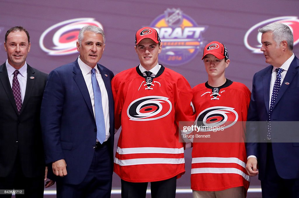 Jake Bean celebrates with the Carolina Hurricanes after being selected 13th during round one of the 2016 NHL Draft on June 24, 2016 in Buffalo, New York.