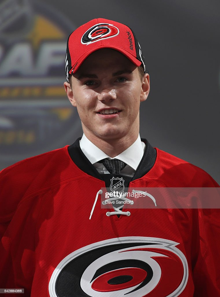 Jake Bean smiles onstage after being selected 13th overall by the Carolina Hurricanes during round one of the 2016 NHL Draft at First Niagara Center on June 24, 2016 in Buffalo, New York.