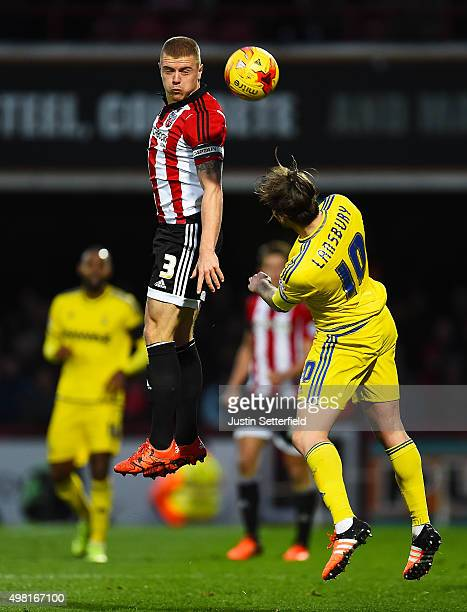 Jake Bidwell of Brentford and Henri Lansbury of Nottingham Forest during the Sky Bet Championship match between Brentford and Nottingham Forest at...
