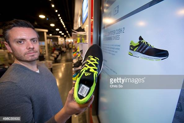 TORONTO ON NOVEMBER 18 2015 Jake Boguski digital technology manager for FGL Sports the parent company of Sport Check shows an Adidas sports athletic...