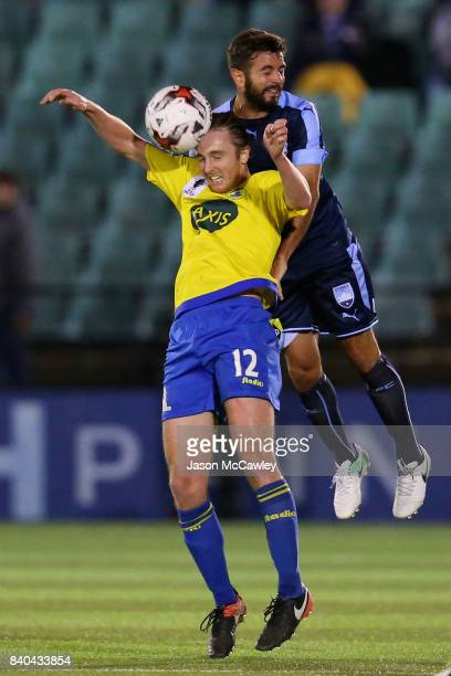 Jake Bradshaw of the Berries and Michael Zullo of Sydney compete for the ball during the round of 16 FFA Cup match between the Bankstown Berries and...
