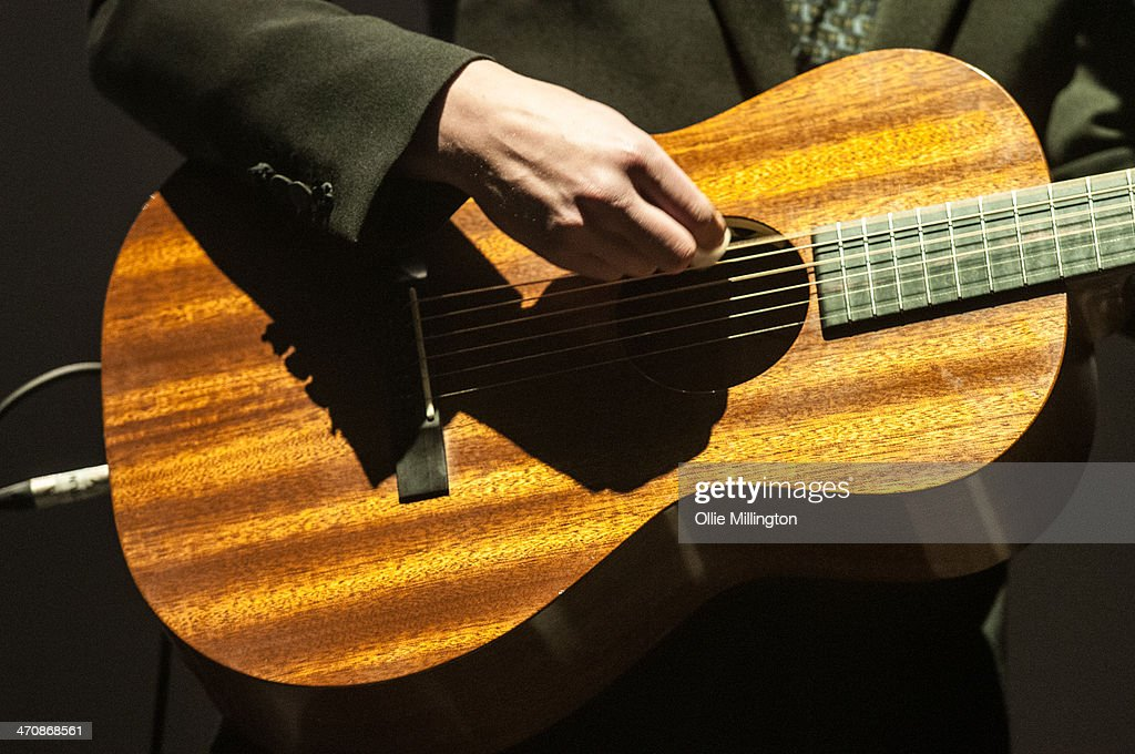Jake Bugg (guitar detail) performs on the opening night of his UK tour to a home city crowd on stage at Nottingham Capital FM Arena on February 20, 2014 in Nottingham, United Kingdom.