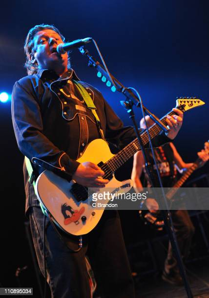 Jake Burns of Stiff Little Fingers performs on stage at HMV Forum on March 25 2011 in London England