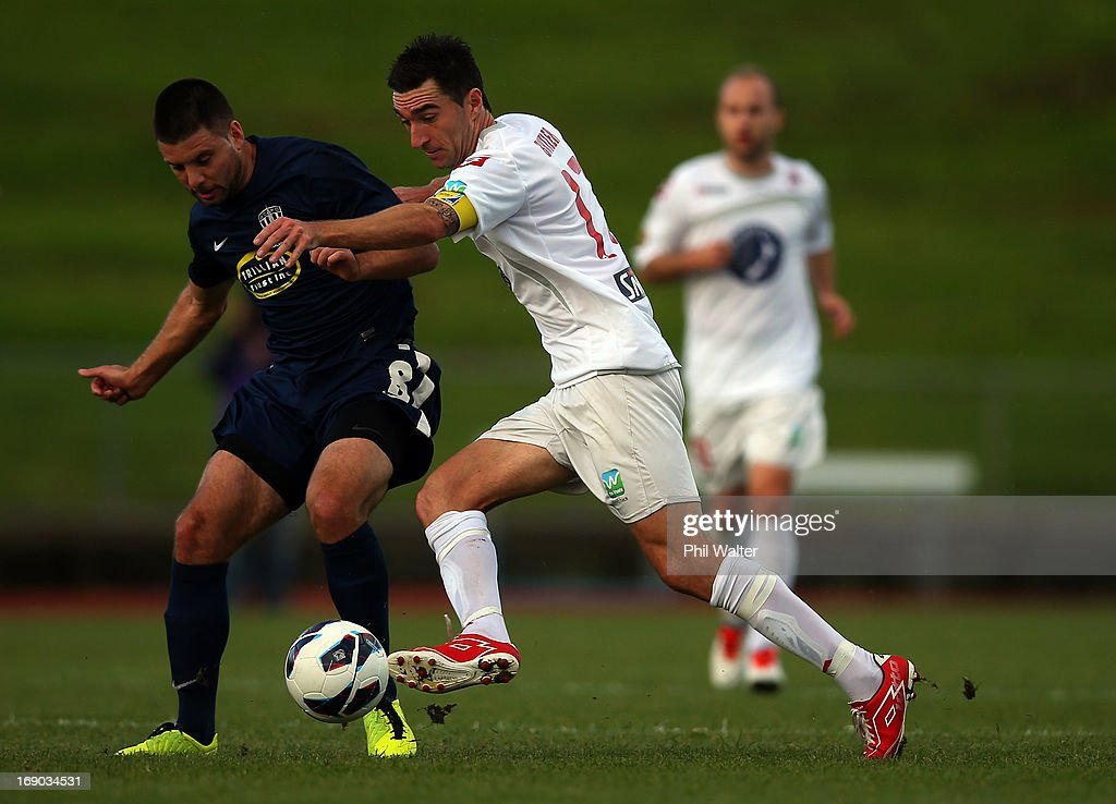 Jake Butler of Waitakere is pressured by Chris Bale of Auckland during the OFC Champions League Final match between Auckland and Waitakere at Mt Smart Stadium on May 19, 2013 in Auckland, New Zealand.