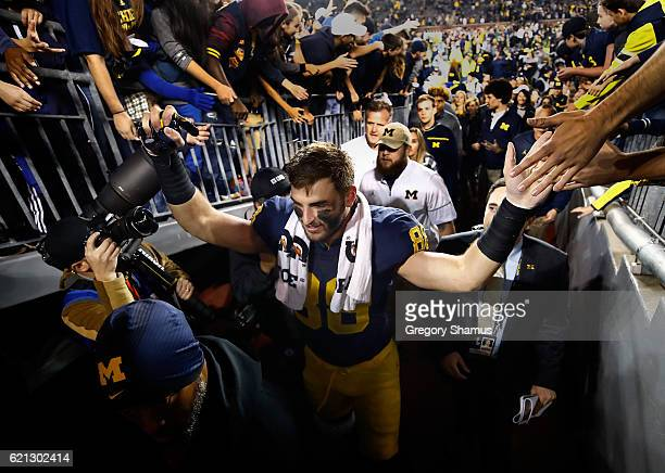 Jake Butt of the Michigan Wolverines celebrates a 593 win over the Maryland Terrapins with fans on November 5 2016 at Michigan Stadium in Ann Arbor...