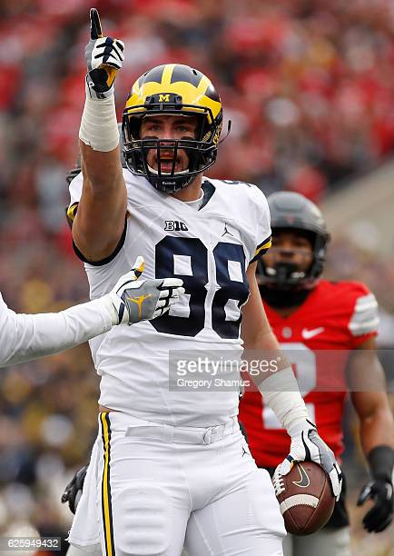 Jake Butt of the Michigan Wolverines reacts after catching a pass for a first down during the first half against the Ohio State Buckeyes at Ohio...