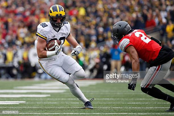 Jake Butt of the Michigan Wolverines runs after catching a pass during the first half against the Ohio State Buckeyes at Ohio Stadium on November 26...