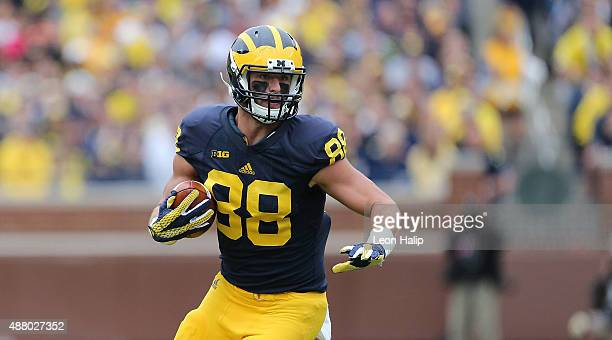 Jake Butt of the Michigan Wolverines runs for a first down during the third quarter of the game against the Oregon State Beavers on September 12 2015...