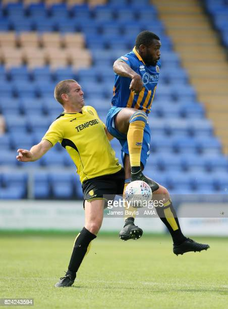Jake Buxton of Burton Albion and Lenell JohnLewis of Shrewsbury Town during the PreSeason Friendly between Shrewsbury Town and Burton Albion at the...