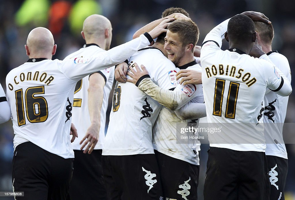 Jake Buxton of Derby (C) celebrates with team mates after scoring his team's second goal of the game during the npower Championship match between Derby County and Leeds United at Pride Park on December 8, 2012 in Derby, England.