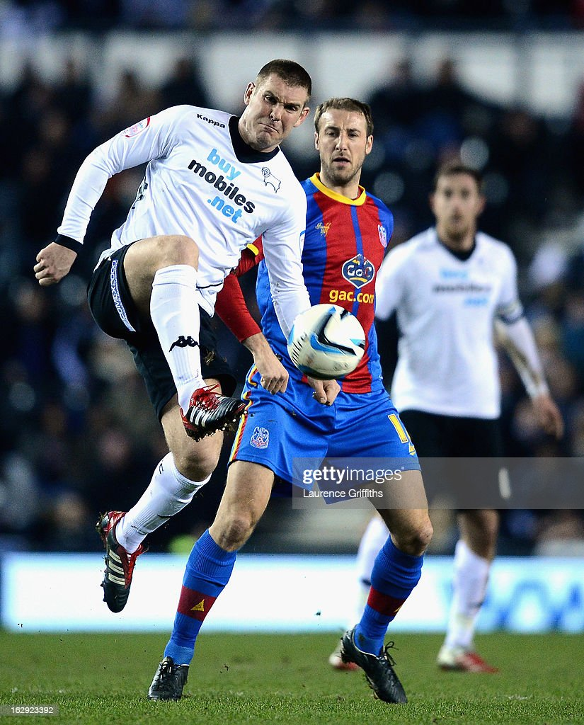 Jake Buxton of Derby County battles with Glenn Murray of Crystal Palace during the npower Championship match between Derby County and Crystal Palace at Pride Park Stadium on March 1, 2013 in Derby, England.